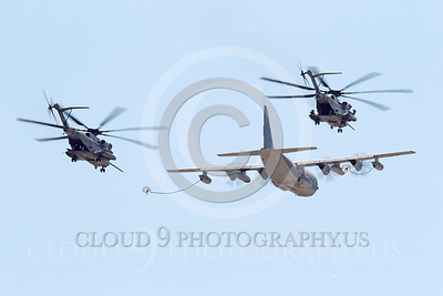 AAR 00118 A USMC Lockheed KC-130 Hercules and two USMC Sikorsky CH-53 Sea Stallion helicopters prepare to aerial refuel airplane picture, by Peter J Mancus