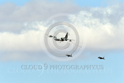 AAR 00100 A USMC Lockheed KC-130 Hercules and two USMC McDonnell Douglas AV-8B VSTOL jet attack aircraft prepare to aerial refuel airplane pictures, by Peter J Mancus