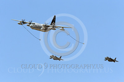 AAR 00101 A USMC Lockheed KC-130 Hercules and two USMC McDonnell Douglas AV-8B VSTOL jet attack aircraft prepare to aerial refuel airplane pictures, by Peter J Mancus