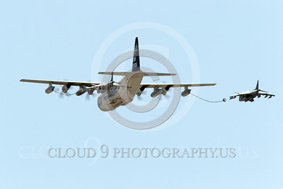 AAR 00103 A USMC Lockheed KC-130 Hercules and two USMC McDonnell Douglas AV-8B VSTOL jet attack aircraft prepare to aerial refuel airplane picture, by Peter J Mancus