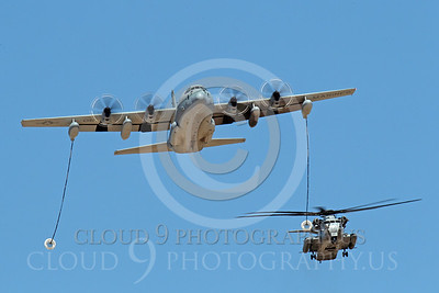 AAR 00116 A USMC Lockheed KC-130 Hercules and a USMC Sikorsky CH-53 Sea Stallion helicopter prepare to aerial refuel airplane picture, by Peter J Mancus