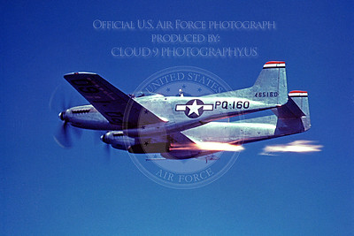 F-82 00006 A USAF North American P-82B Twin Mustang in flight with a rocket assist engine or firing rockets, military airplane picture, Official USAF Picture