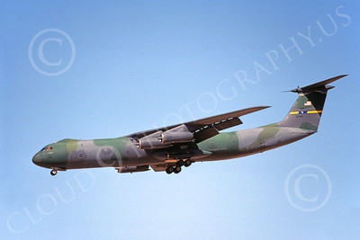 C-141BUSAF 00024 A landing USAF Lockheed C-141B StarLifter 67945 3-1993 military airplane picture by Carl E Porter
