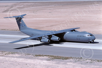 C-141BUSAF 00023 A taxing gray USAF Lockheed C-141B StarLifter with nose blisters Travis AFB military airplane picture by Peter J Mancus