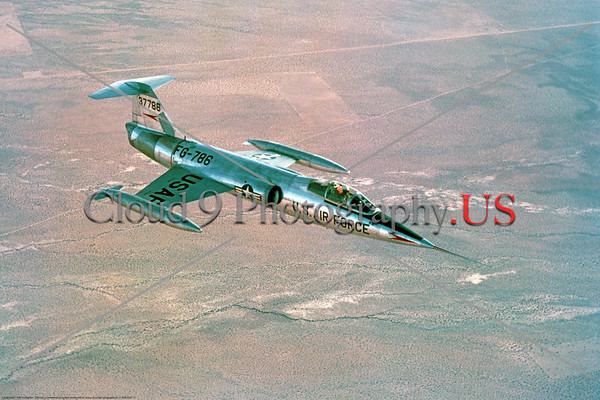 F-104USAF 0012 An early Lockheed F-104 Starfighter, USAF Century Series Cold War era supersonic jet fighter, 37786, flying over desert near Edwards AFB, official Lockheed Aircraft photograph produced by Cloud 9 Photography     DT copy