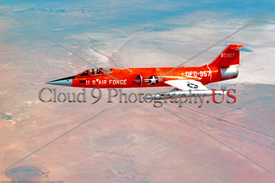 F-104USAF 0028 A flying, pretty, red, Lockheed QF-104 Starfighter, USAF 52957, official Lockheed Aircraft photograph produced by Cloud 9 Photography     DT copy