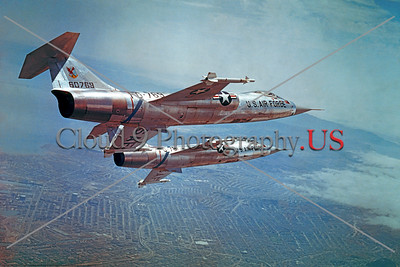 F-104USAF 0014 Two flying Lockheed F-104 Starfighters, USAF Air Defense Command Cold War era anti-bomber interceptors, official Lockheed Aircraft photograph produced by Cloud 9 Photography     DT copy