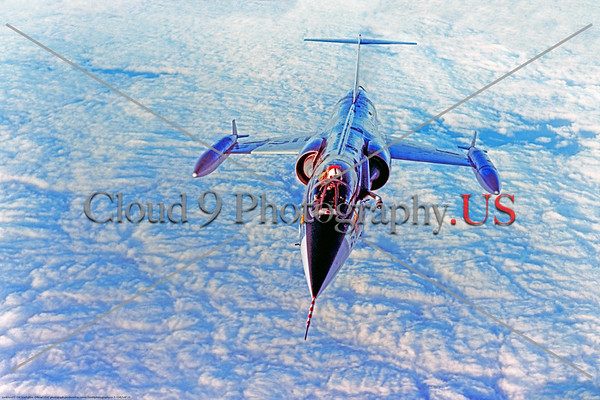 F-104USAF 0010 A beautiful portrait of a flying Lockheed F-104 Starfighter, a supersonic USAF Century Series Cold War era jet fighter, flying above clouds, official USAF photograph produced by Cloud 9 Photography     DT copy