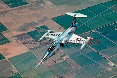 F-104USAF 0016 A beautiful flying portrait of a Lockheed F-104 Starfighter, USAF Cold War era supersonic jet fighter, official Lockheed Aircraft photograph produced by Cloud 9 Photography     DT copy