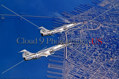 F-104USAF 0030 Two flying bare metal Air Defense Command Lockheed F-104 Starfighter USAF Cold War era anti-bomber interceptor, official Lockheed Aircraft photograph produced by Cloud 9 Photography     DT copy