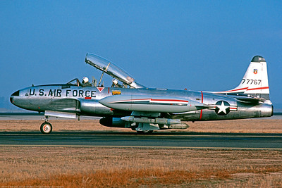 T-33USAF 00035 A Lockheed T-33 Shooting Star USAF jet trainer 77767 84th FIS taxis at Castle AFB for take-off 6-1977 military airplane picture by Peter J Mancus     DONEwt copy