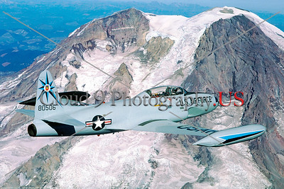 T-33USAF-318FIS 002 A Lockheed T-33 Shooting Star, USAF jet trainer, 80506, 318th FIS GREEN DRAGONS, flying over a snow capped mountain in Washington state, 10-1987, military airplane picture by Peter J Mancus     Dt