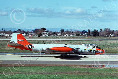 B-57USAF 00035  taxing gray-orange USAF Martin B-57 Canberra 54242 McClellan AFB 3-1975, by Michael Grove, Sr