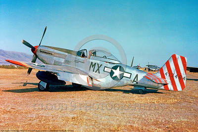 P-51 00005 A static striped tail US Army Air Force North American P-51 Mustang with thirteen German kills, military airplane picture, Official USAF Picture produced by Cloud 9 Photography