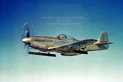 P-51 00014 A flying North American P-51D Mustang with large rocket launchers,military airplane picture, Official USAF Picture