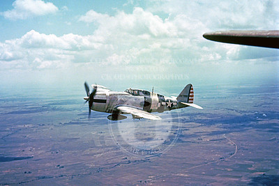 P-47 00002 An in-flight WWII era Republic P-47 Thunderbolt with invasion stripes, military airplane picture, Official USAF picture