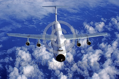 C-5USAF 0002 A flying Lockheed C-5 Galaxy USAF heavy lift cargo jet flying over the Pacific Ocean military airplane picture by Peter J Mancus