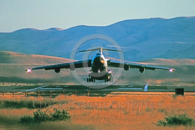 C-5USAF 0020 A Lockheed C-5A Galaxy USAF heavy lift cargo jet takes-off Travis AFB 7-1983 military airplane picture by Peter J Mancus