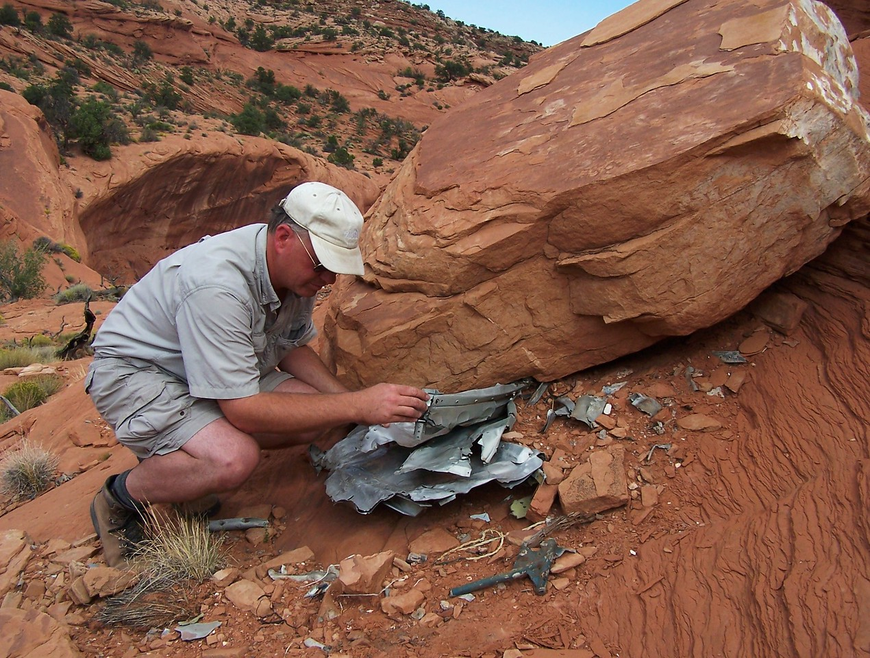 This wreckage was wedged under a large sandstone boulder. The boulder probably rolled down onto the wreckage after impact.