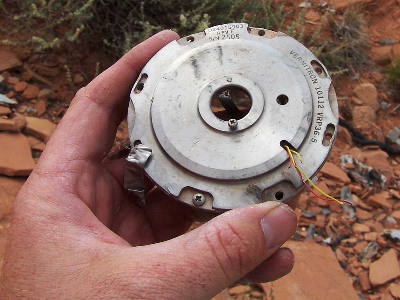 A cap/cover assembly from a Vernitron pressure sensor.