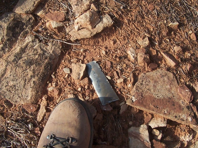 The area was scattered with turbine blades. It was rumoured by many that the tail section hit the edge of the mesa first. However, the on-site evidence during my visit indicates a wing and engine pylon made the first contact.