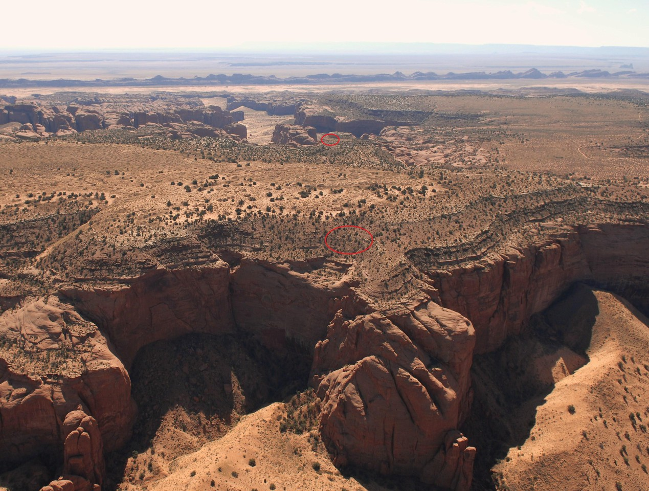 This aerial photo taken of Hunts Mesa at an altitude of 7,000 feet illustrates the B-52's initial collision with the north edge of the mesa (large red oval) and the final impact point (small red oval) nearly 3,500 feet away. (Photo taken 9/29/08)