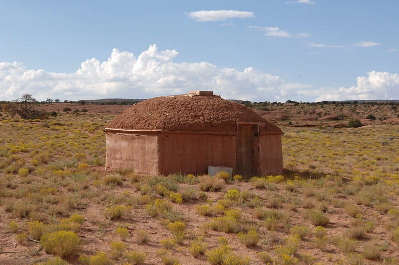 "Traditional housing for the Navajo Indian is the ""Hogan"". This one is made of logs with plaster walls and a mud roof.<br /> <br /> Thank you for viewing.<br /> <br /> THE END."