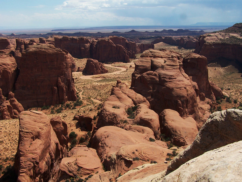 A view off the eastern side of the bluff showing Double Arch Canyon as it winds its way to the southeast.