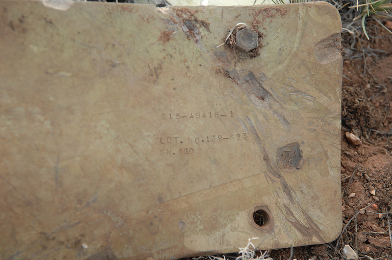"This fragment contained a part number and manufacturer's inspection stamp. The prefix of ""215"" on the part number designates the aircraft make and type as being that of an A-7 Corsair. (2008 LostFlights)"