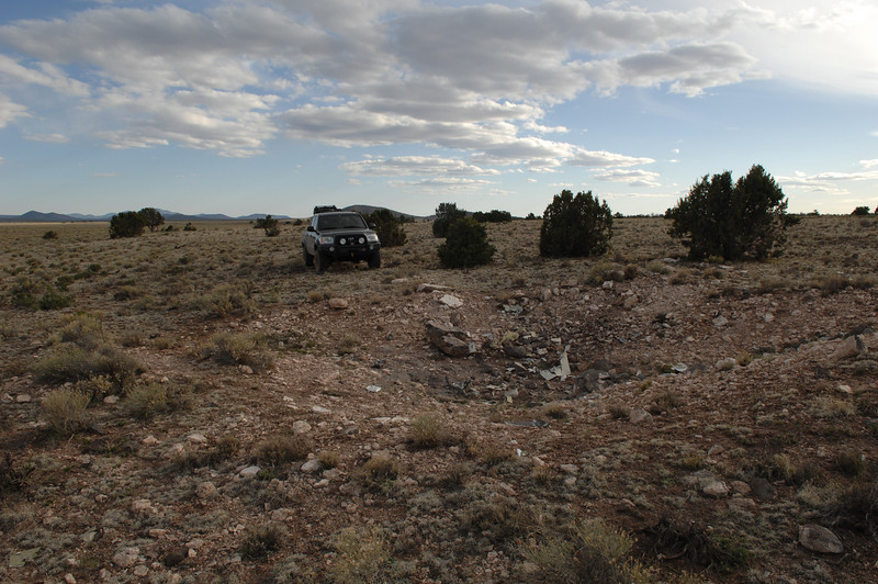 The impact crater looking south. No roads lead directly to this crash site and most of the travel was made by truck on open range land. (2008 LostFlights)