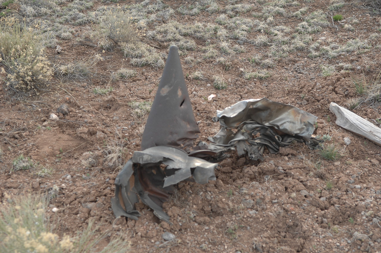 The remaining section of the engine's tailcone exhaust assembly amid other titanium alloy fragments. (2008 LostFlights)