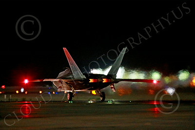 AB-F-22 00001 A Lockheed F-22 Raptor stealth jet fighter USAF TY code takes off in afterburner at Nellis AFB during a night Red Flag mission 7-2014 military airplane picture by Peter J Mancus