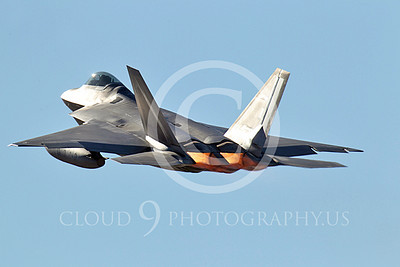 AB - F-22 00054 A USAF Lockheed Martin F-22 Raptor with under-wing fuel tanks seen taking off from Nellis AFB during a Red Flag exercise, by Peter J Mancus