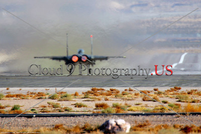 AB-F-15USAF 0002 A McDonnell Douglas F-15 Eagle USAF air superiority jet figher on Nellis AFB's runway in afterburner ready for take-off, 2-2012, military airplane picture by Peter J Mancus     DT copy