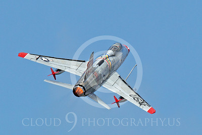 WB - F-100 00022 A flying North American F-100F Super Sabre USAF jet fighter, FW-948 63948, warbird climbs for altitude using afterburner assist, by Peter J Mancus
