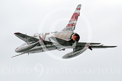 WB - F-100 00056 A flying North American F-100F Super Sabre USAF jet fighter, FW-948 63948, warbird in afterburner, by Peter J Mancus