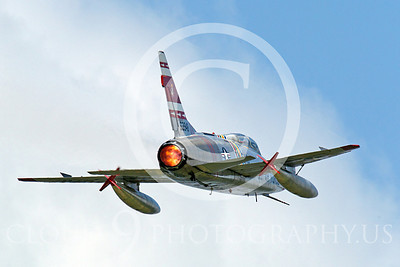 WB - F-100 00048 A flying North American F-100F Super Sabre USAF jet fighter, FW-948 63948, warbird in full afterburner, by Peter J Mancus