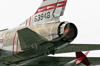 WB - F-100 00080 Close up of the afterburner of a flying North American F-100F Super Sabre USAF jet fighter, FW-948 63948, warbird, by Peter J Mancus