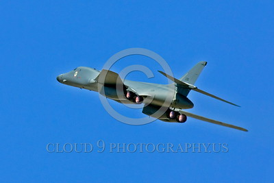 AB-B-1USAF 00026 A flying USAF Rockwell B-1B Lancer strategic jet bomber in afterburner zooms up military airplane picture by Peter J Mancus tif