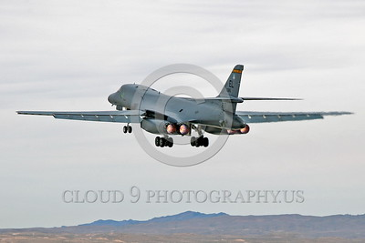 AB-B-1USAF 00015 A USAF Rockwell B-1B Lancer strategic jet bomber 85085 EL code T-BIRDS takes off at Nellis AFB in full afterburner military airplane picture by Peter J Mancus