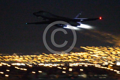 AB-B-1USAF 00028 A USAF Rockwell B-1B Lancer strategic jet bomber takes off at night at Nellis AFB in full afterburner military airplane picture by Peter J Mancus tif