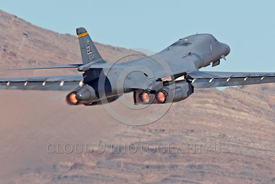 AB-B-1USAF 00005 A USAF Rockwell B-1B Lancer strategic jet bomber 37BS 86094 EL code takes off at Nellis AFB in full afterburner military airplane picture by Peter J Mancus