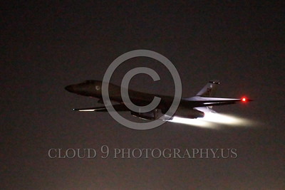 AB-B-1USAF 00025 A USAF Rockwell B-1B Lancer strategic jet bomber takes off at night at Nellis AFB in full afterburner military airplane picture by Peter J Mancus tif
