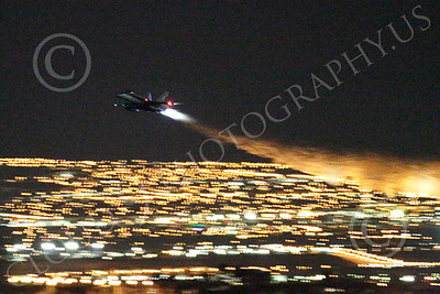 AB - F-18USN-L 00018 McDonnell Douglas F-18 Hornet US Navy in afterburner at night by Peter J Mancus