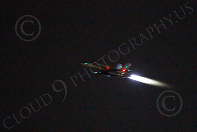 AB - F-18USN-L 00012 McDonnell Douglas F-18 Hornet US Navy in afterburner at night by Peter J Mancus