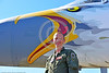 ACM 00436 Portrait of an Oregon Air National Guard F-15 Eagle jet fighter pilot in front of his jet's unique large eagle head nose art at Reno Air Races 2016, by Peter J  Mancus