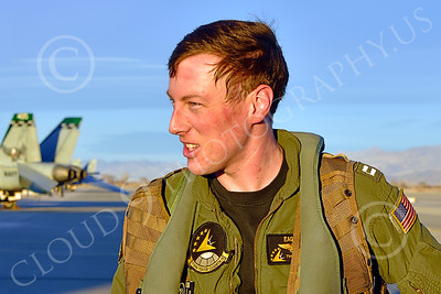 ACM 00418 The reddish curved line and moist matted hair on this smiling young US Navy F-18 Super Hornet jet fighter pilot indicates he worked up a sweat during a training flight, working hard in the cockpit, aircrew picture by Peter J Mancus