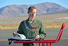 ACM 00424 Portrait of an Oregon Air National Guard F-15 Eagle jet fighter pilot reviewing documentation on his jet's readiness for flight status at Reno Air Races 2016, by Peter J  Mancus