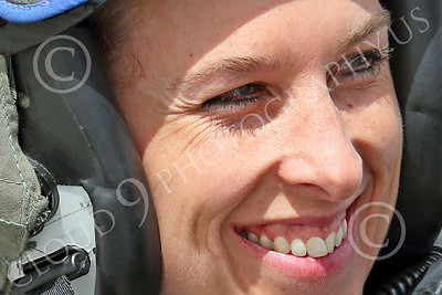 ACM 00413 The eyes on this smiling USN F-16 fighter pilot belong to a professional, deadly, female aerial assassin, 2014 NAS Fallon, by Peter J Mancus