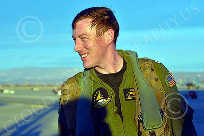 ACM 00417 The reddish curved line and moist matted hair on this smiling young US Navy F-18 Super Hornet jet fighter pilot indicates he worked up a sweat during a training flight, working hard in the cockpit, aircrew picture by Peter J Mancus